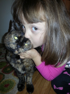 We adopted Marge, a senior tortie cat, about a month ago. She is doing wonderfully and we adore her. She is the perfect cat for us. My four year old daughter had begged for a cat for many months. She was clear about wanting a calm, loving cat, and that is Marge to a T. She is so sweet and loving and patient. She has her claws, but has not ever scratched a person or a furniture in the house, nor has she bitten or hissed. My daughter loves her to pieces and there is no greater joy to me than hearing her talk about how much she loves her cat. Marge is now named Callie, but no matter what her name, she is loving with a huge purr to match. She patiently puts up with the overzealous attentions of a four year old girl, and has settled into her new home very nicely, with favorite sleeping spots on an orange cushion on a window ledge in the sun, my desk chair, or at our feet in bed. Our house feels so much warmer with her in it. We love her and are happy to have her here. Thank you for looking after her all those long months and making sure she had plenty of attention and affection. The vet said she was in wonderful health with zero issues, which is remarkable for a cat of her age, and a testament to both her former owner and the RI SPCA. ~ Marge's new family